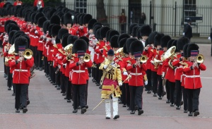 LONDON, ENGLAND - JUNE 15: Guards march during the annual Trooping the Colour Ceremony on June 15, 2013 in London, England. Today's ceremony which marks the Queens official birthday will not be attended by Prince Philip the Duke of Edinburgh as he recuperates from abdominal surgery and will also be The Duchess of Cambridge's last public engagement before her baby is due to be born next month. (Photo by Chris Jackson/Getty Images)